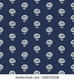 Indigo dye woodblock printed seamless ethnic floral all over pattern. Traditional oriental ornament of India, flowers of Kashmir, with dandelions, ecru on navy blue background. Textile design.