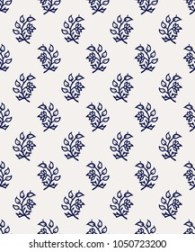 Indigo dye woodblock printed seamless ethnic floral all over pattern. Traditional oriental ornament of India, flowers of Kashmir, navy blue on ecru background. Textile design.