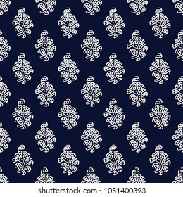 Indigo dye woodblock printed seamless ethnic floral all over pattern. Traditional oriental ornament of India, peony flowers of Kashmir, ecru on navy blue background. Textile design.