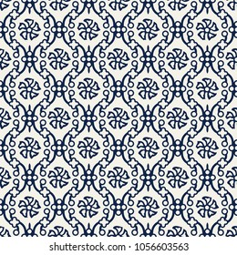Indigo dye woodblock printed seamless ethnic floral damask pattern. Traditional oriental ornament of India Kashmir, flowers on ogee molding, navy blue on ecru background. Textile design.