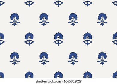Indigo dye woodblock printed seamless ethnic floral all over pattern. Traditional oriental ornament of India, flowers of Kashmir, with dandelions, navy blue and cobalt on ecru background. Textile