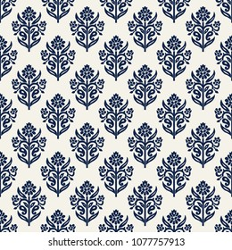 Indigo dye woodblock printed seamless ethnic floral all over pattern. Traditional oriental ornament of India, lily flowers of Kashmir, navy blue on ecru background. Textile design.