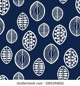 Indigo dye woodblock printed seamless ethnic floral pattern. Primitive oriental ornament, various stylized leaves or fruits, ecru on navy blue background. Textile design.