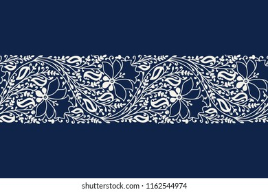 Indigo dye woodblock printed seamless ethnic floral border. Traditional oriental ornament of India, garland of flowers and leaves, ecru on  navy blue background. Textile design.