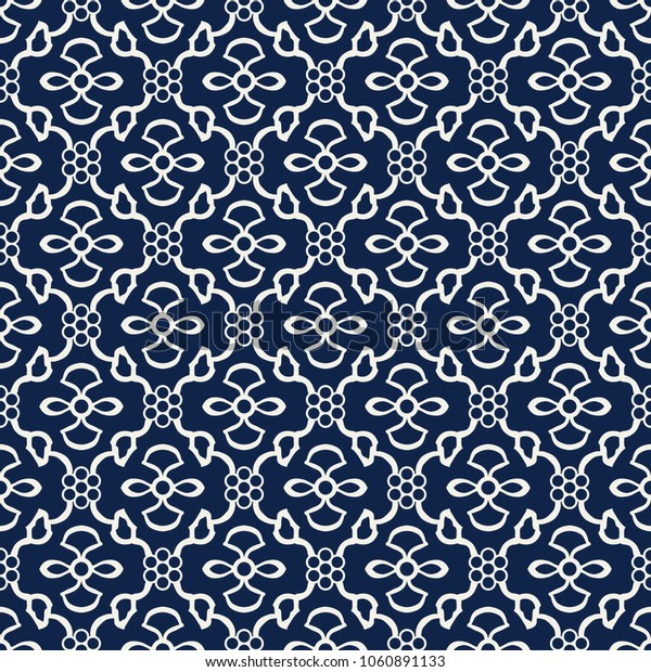 Indigo dye woodblock printed seamless ethnic floral damask pattern. Traditional oriental ornament of India Kashmir, ogee molding and geometric flowers, ecru on  navy blue  background. Textile design.