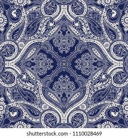 Indigo dye woodblock printed traditional paisley pattern. Abstract geometric lace oriental ornament. Ecru outlines on navy background. Textile design.