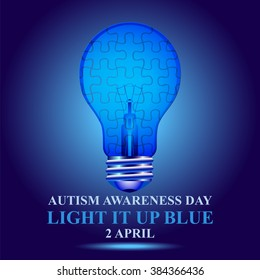 Indigo light bulb with puzzle. Autism awareness day concept. Light it on blue.