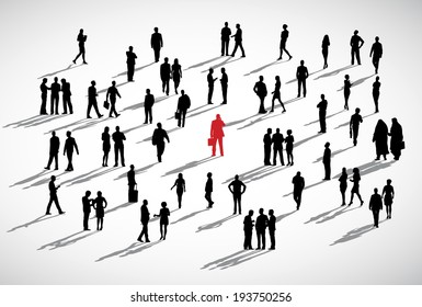An individual businessman standing admist the crowd of business people.