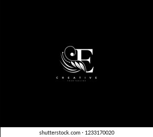 Initial E letter luxury beauty flourishes ornament monogram logo