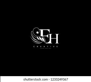 Initial EH letter luxury beauty flourishes ornament monogram logo