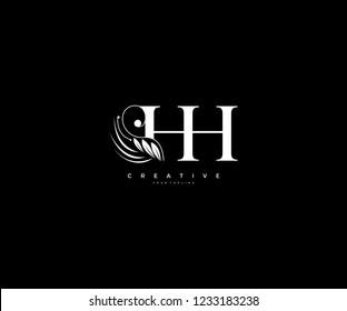 Initial HH letter luxury beauty flourishes ornament monogram logo