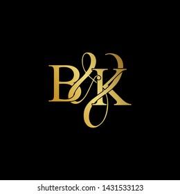 Initial letter B & K BK luxury art vector mark logo, gold color on black background.