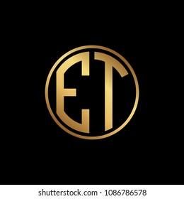 Initial letter ET, minimalist art monogram circle shape logo, gold color on black background