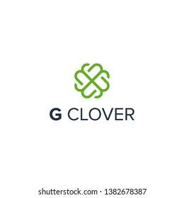 initial letter G with Irish clover shamrock leaf logo design