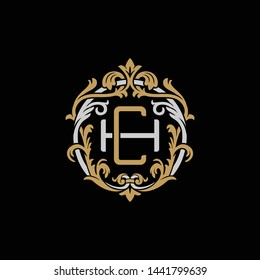 Initial letter H and C, HC, CH, decorative ornament emblem badge, overlapping monogram logo, elegant luxury silver gold color on black background