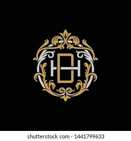 Initial letter H and D, HD, DH, decorative ornament emblem badge, overlapping monogram logo, elegant luxury silver gold color on black background