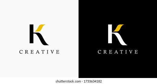 Initial Letter H and K Linked Logo. Black and Gold Lettering Calligraphy Style isolated on Double Background. Usable for Business, Beauty and Fashion Logos. Flat Vector Logo Design Template Element.