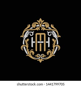 Initial letter H and M, HM, MH, decorative ornament emblem badge, overlapping monogram logo, elegant luxury silver gold color on black background