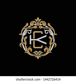 Initial letter K and C, KC, CK, decorative ornament emblem badge, overlapping monogram logo, elegant luxury silver gold color on black background