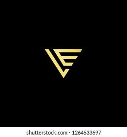 Initial letter LE EL VE EV minimalist art logo, gold color on black background.