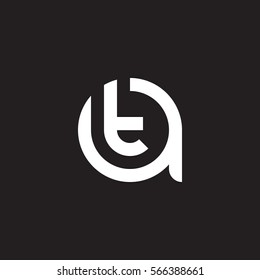 initial letter logo at, ta, t inside a rounded lowercase white black background