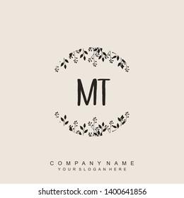 Initial letter MT beautiful handwriting logo vector template