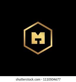 Initial letter MT TM minimalist art monogram Hexagon shape logo, gold color on black background