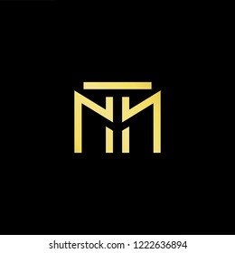 Initial letter MT TM minimalist art logo, gold color on black background.