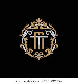 Initial letter T and M, TM, MT, decorative ornament emblem badge, overlapping monogram logo, elegant luxury silver gold color on black background