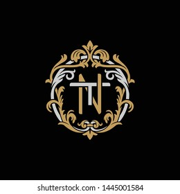 Initial letter T and N, TN, NT, decorative ornament emblem badge, overlapping monogram logo, elegant luxury silver gold color on black background