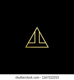 Initial letter AT TA minimalist art logo, gold color on black background.