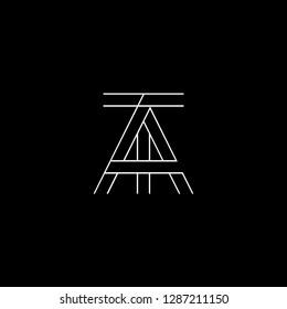 Initial letter AT TA minimalist monogram art logo, white color on black background.