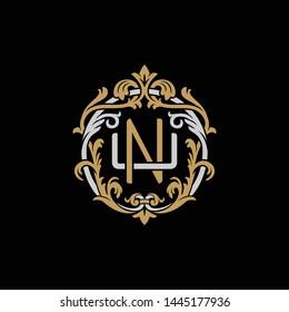 Initial letter U and N, UN, NU, decorative ornament emblem badge, overlapping monogram logo, elegant luxury silver gold color on black background