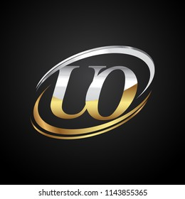 initial letter UO logotype company name colored gold and silver swoosh design. isolated on black background.