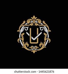 Initial letter V and U, VU, UV, decorative ornament emblem badge, overlapping monogram logo, elegant luxury silver gold color on black background