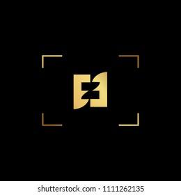 Initial letter Z NZ ZN minimalist art monogram shape logo, gold color on black background