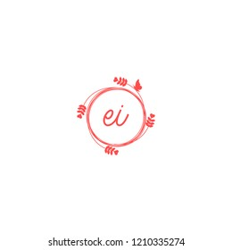initial letters ei beauty spa logo design, with flower, love and butterfly illustration