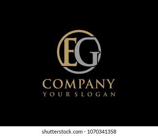 EG initial letters looping linked circle elegant logo golden silver black background
