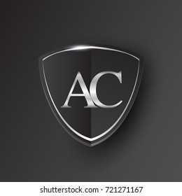 Initial logo letter AC with shield Icon silver color isolated on black background, logotype design for company identity.