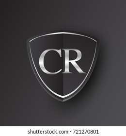 Initial logo letter CR with shield Icon silver color isolated on black background, logotype design for company identity.