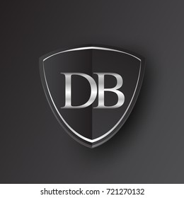 Initial logo letter DB with shield Icon silver color isolated on black background, logotype design for company identity.