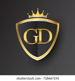 Initial logo letter GD with shield and crown Icon golden color isolated on black background, logotype design for company identity.
