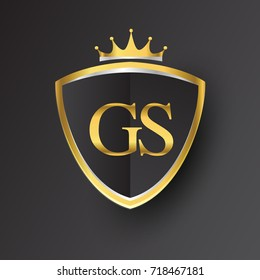 Initial logo letter GS with shield and crown Icon golden color isolated on black background, logotype design for company identity.
