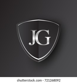 Initial logo letter JG with shield Icon silver color isolated on black background, logotype design for company identity.
