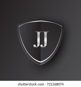 Initial logo letter JJ with shield Icon silver color isolated on black background, logotype design for company identity.