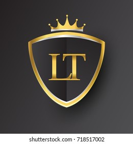 Initial logo letter LT with shield and crown Icon golden color isolated on black background, logotype design for company identity.