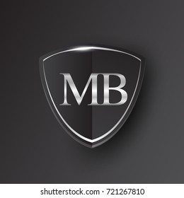 Initial logo letter MB with shield Icon silver color isolated on black background, logotype design for company identity.