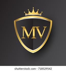 Initial logo letter MV with shield and crown Icon golden color isolated on black background, logotype design for company identity.