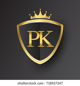 Initial logo letter PK with shield and crown Icon golden color isolated on black background, logotype design for company identity.
