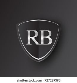 Initial logo letter RB with shield Icon silver color isolated on black background, logotype design for company identity.
